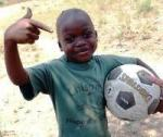 smiling boy with a football